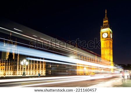 Traffic in night London, UK, in front of the big ben and the house of parliament - stock photo