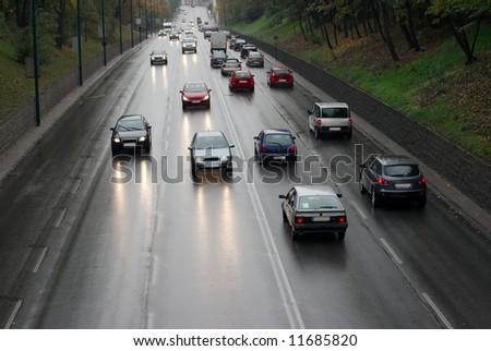 Traffic in rain - stock photo
