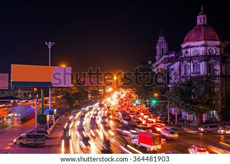Traffic in Yangon Myanmar at night - stock photo
