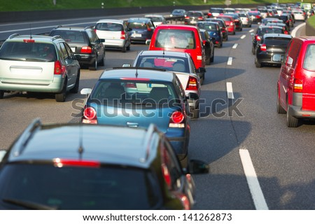 Traffic jam on a freeway - stock photo