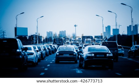 traffic jam on highway,shanghai china.blue toned image. - stock photo