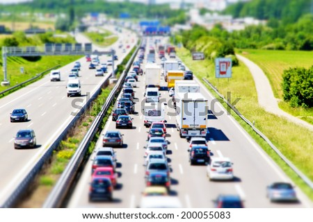 Traffic jam on Stuttgart highway, tilt shift effect - stock photo