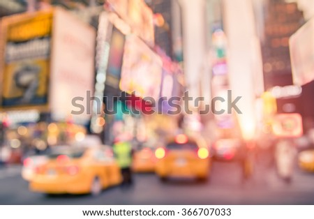 Traffic jam with defocused yellow taxi cabs and rush hour on Times Square in Manhattan downtown at sunset - Blurred bokeh postcard of New York City on a vivid bright marsala color filtered look - stock photo