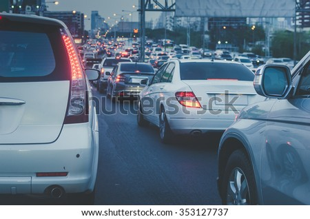 traffic jam with row of car on express way before night - vintage style picture - stock photo