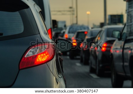traffic jam with row of cars on expressway during rush hour - stock photo