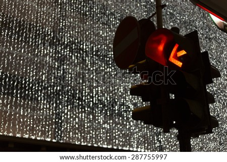 traffic light and christmas decoration on background - stock photo