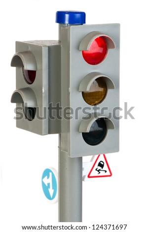 Traffic light illuminated toy. Red signal - stock photo