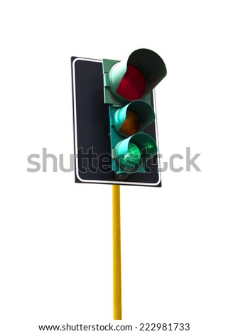 Traffic light isolated on white background is lit green - stock photo