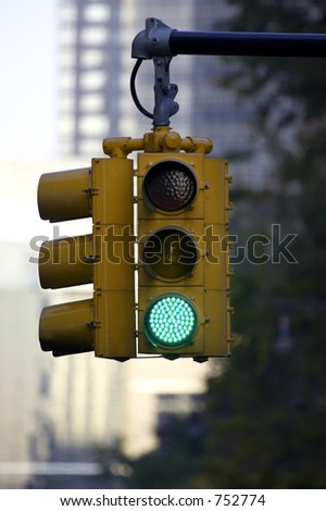 Traffic light on green, Manhattan, New York, America, USA - stock photo