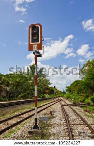 Traffic light on railway track - stock photo