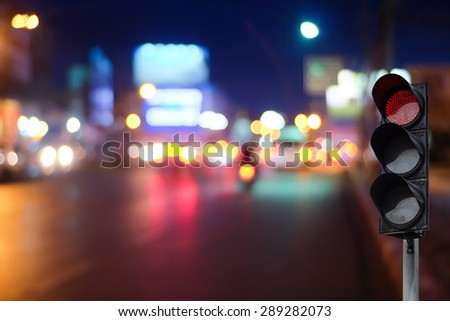 Traffic light on the road during the night. - stock photo