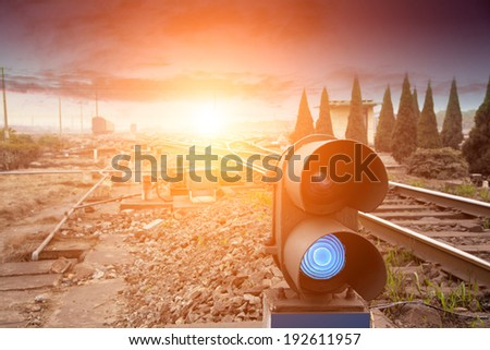 Traffic light shows green signal on railway. Green light - stock photo