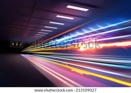 Traffic light trails through an urban setting. Super fast light beams. - stock photo