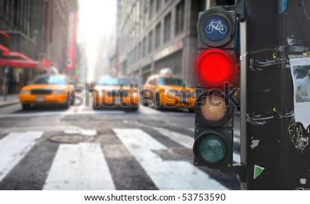 Traffic light with red light on a city street - stock photo