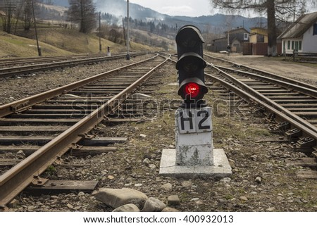 traffic light with red signal on the railroad - stock photo
