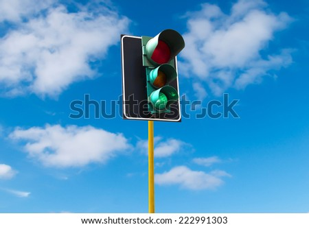 Traffic lights against the sky is lit green - stock photo