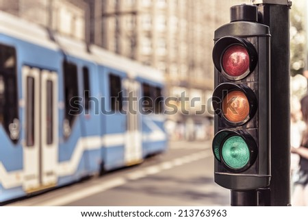 Traffic lights and city tram in Krakow, Poland. - stock photo