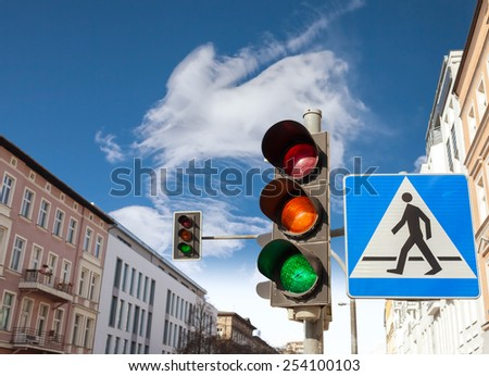 Traffic lights and pedestrian crossing sign in a city. - stock photo