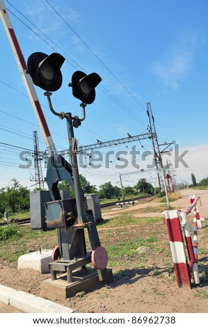 Traffic lights at a railway crossing and railroad. - stock photo
