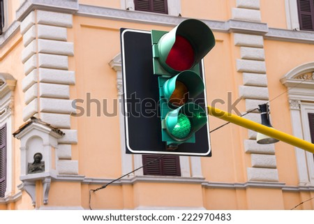 Traffic lights at the crossroads of the city is lit green - stock photo