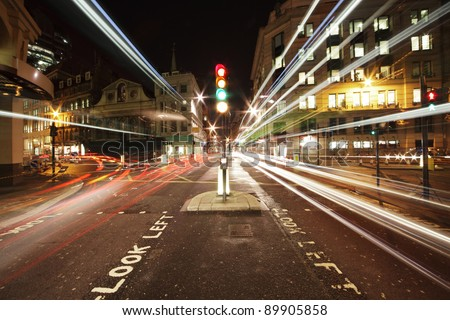 traffic lights in the center of London at night - stock photo