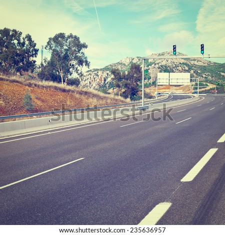 Traffic Lights on the Toll Road Before Entering the Tunnel in Spain, Instagram Effect - stock photo