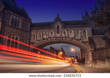 Traffic lights through the Arch of the Christ Church Cathedral in Dublin, Ireland at night - stock photo