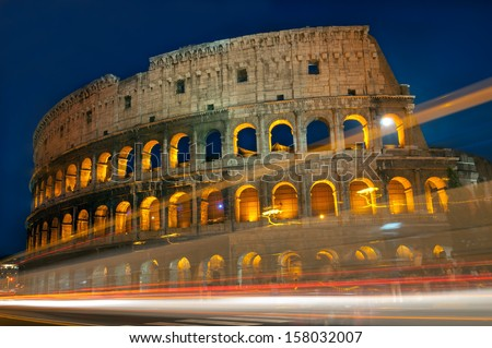 Traffic lights trails passing in front of Colosseum Rome, Italy. - stock photo