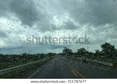 Traffic on a rainy view from window car - stock photo