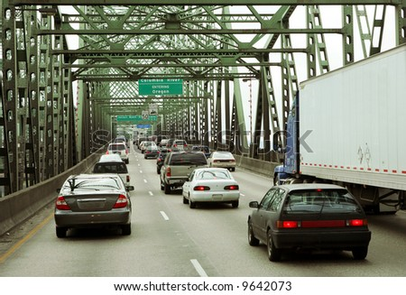Traffic on bridge entering Oregon - stock photo