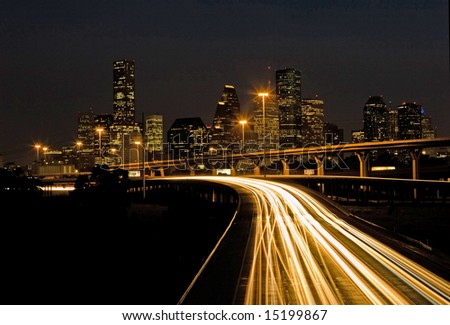 Traffic on highway exiting the city of Houston at night - stock photo