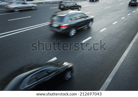 Traffic on highway, motion blur - stock photo