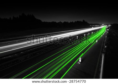 Traffic on highway - representing green - alternative - clean - energy in transportation - stock photo