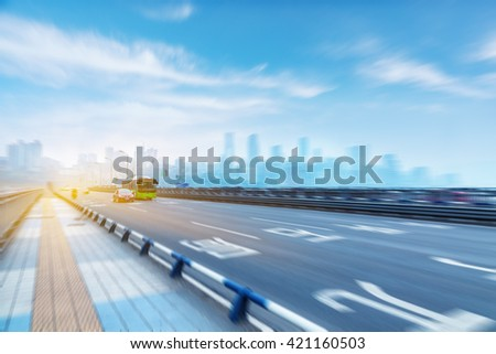 traffic on highway,with city background,chongqing china. - stock photo