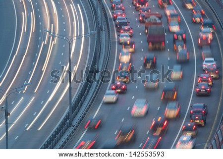 Traffic on highway with motion cars - stock photo