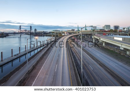 traffic on road with cityscape and skyline of portland  - stock photo