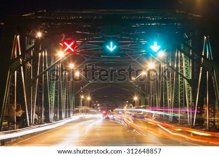 Traffic on the bridge at night. Car traffic on the bridge last night. - stock photo