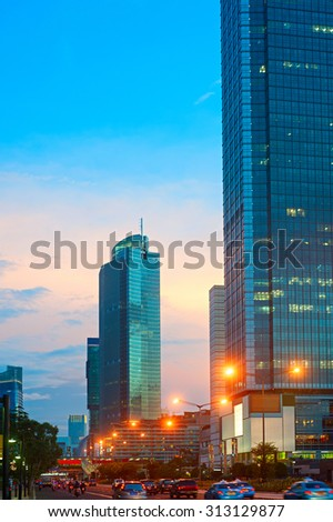 Traffic on the road of Jakarta Central at sunset. Indonesia - stock photo
