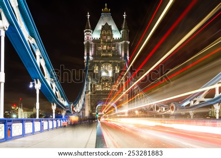 Traffic on Tower bridge at night, London, England - stock photo