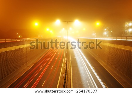 Traffic Road at foggy Night. Long exposure of busy road at dawn.  - stock photo