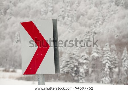 Traffic sign in front of the forest under snow  in the winter - stock photo