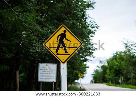Traffic sign pedestrian crossing. - stock photo