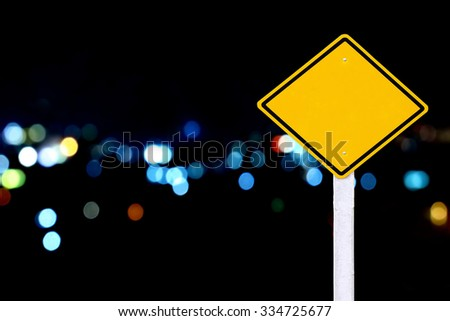 traffic sign post on  blur bokeh light in city background - stock photo