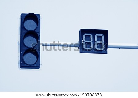 traffic signal lights in the blue sky - stock photo