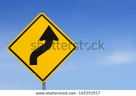 traffic Signs. Narrow radius curve turn right. with blue sky - stock photo