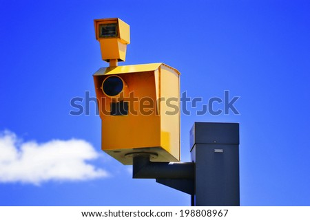 Traffic speed camera over the blue sky. - stock photo