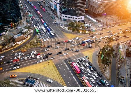 Traffic speeds through an intersection in Gangnam.Gangnam is an affluent district of Seoul. South Korea. - stock photo