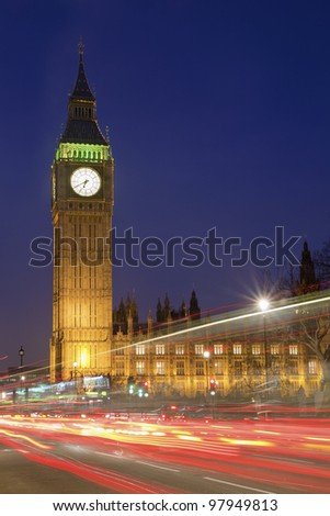 Traffic through London- long exposure with light trails of moving vehicles - stock photo