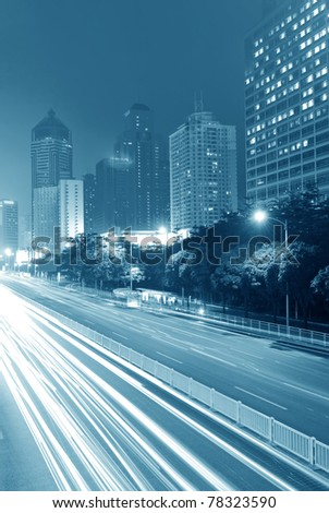 Traffic through the city at night - stock photo