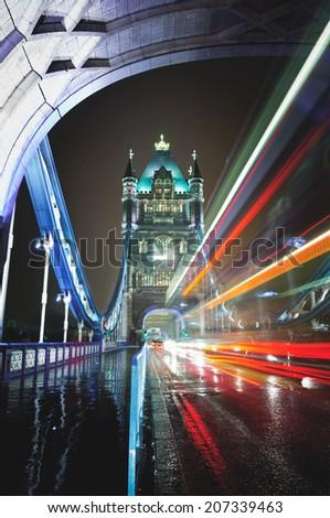 Traffic through Tower Bridge, London. - stock photo